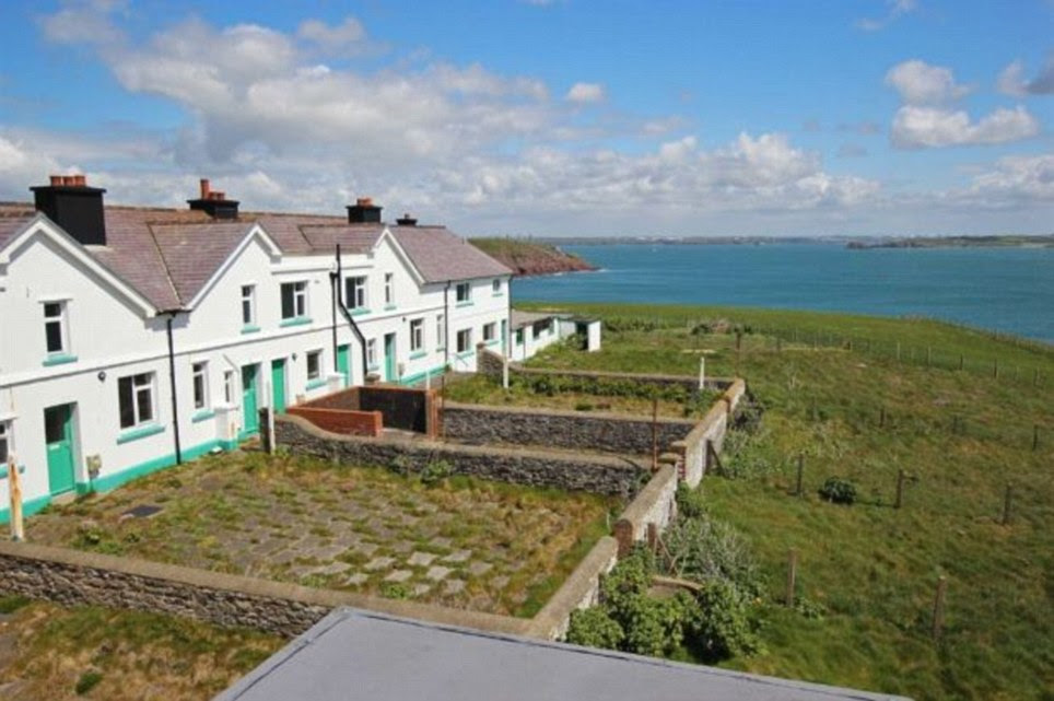 Amazing sea view: The row of cottages which are also available for sale individually. They are all in a poor state of repair