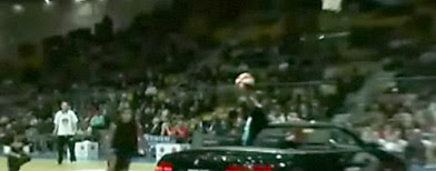Guy Dupuy of And1 Streetball jumps over a convertible at an event in Poland. (screen grab from And1Live)