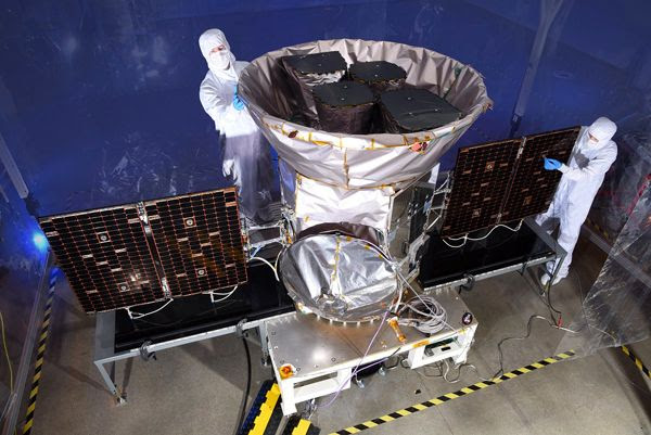 A file photo of Orbital ATK engineers working on NASA's TESS spacecraft...scheduled to launch no earlier than April 16, 2018.