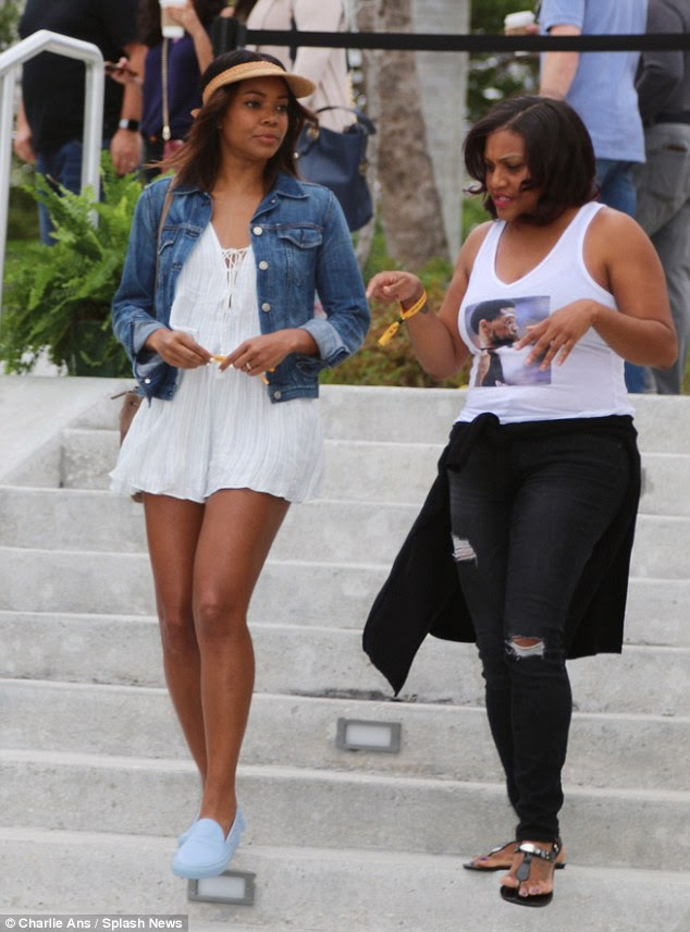 Walk and talk: The Being Mary Jane actress listened to her pal as they descended the stairs