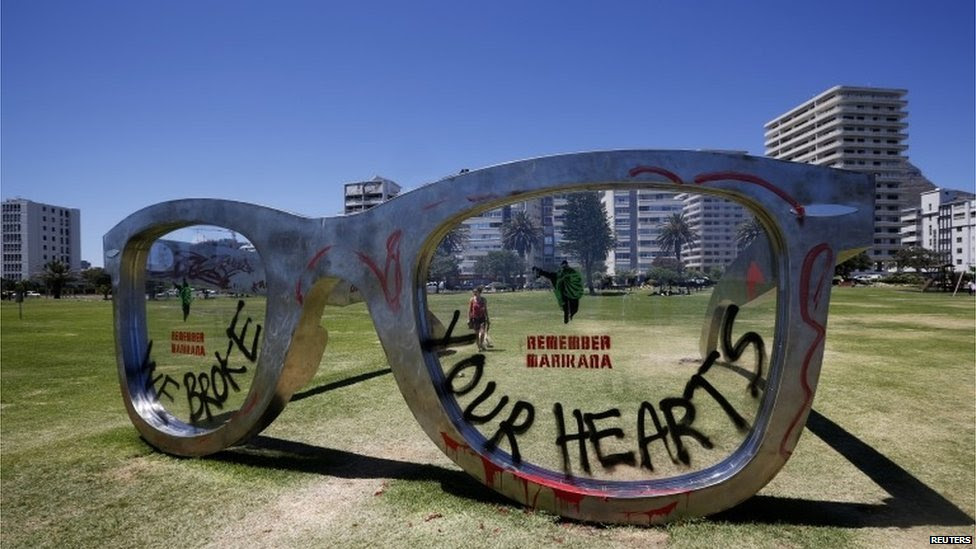 Graffiti covers a sculpture in the form of a giant pair of spectacles on Cape Town's Sea Point Promenade, 18 November 2014