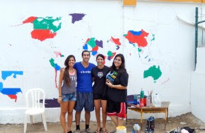 Working with other volunteers on a world map on the island of Tierra Bomba, Colombia.