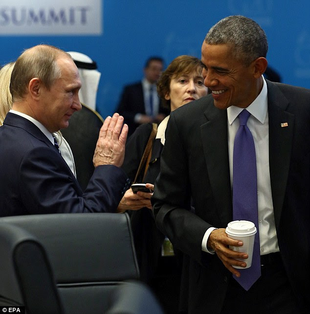 US President Barack Obama appears to share a joke with Mr Putin in sign of relations with Moscow thawing