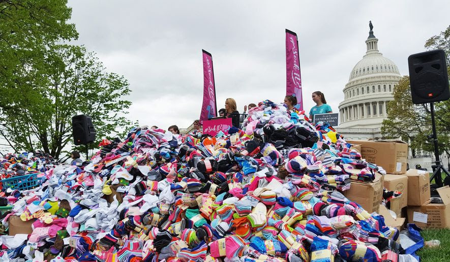 Pro-life demonstrators deliver nearly 200,000 pairs of baby socks Wednesday to the U.S. Capitol as a public demonstration aimed at encouraging Congress to defund Planned Parenthood, the nation's largest abortion provider. (Students for Life of America)