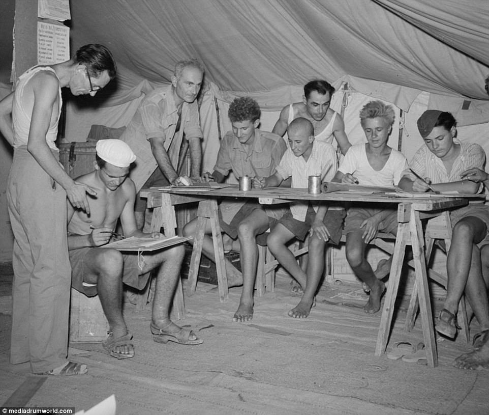 Images show old and young people alike relaxing in the camp and trying to while away the hours by painting, sculpting and letting the children play on a see-saw and swings.The refugees returned home at the beginning of 1946 when the war was over and a more stable political situation in Yugoslavia was established