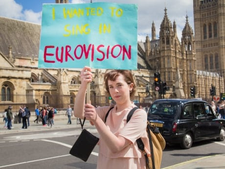 A pro-European Union protester holds a sign near the Palace of Westminster in London on Friday, protesting Britain's decision to leave the European Union.