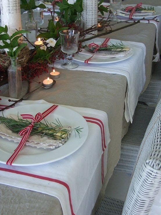 Rustic... Christmas tablescape by Gingervint I like the idea of the sprig of holly or fresh rosemary tied to the plate.