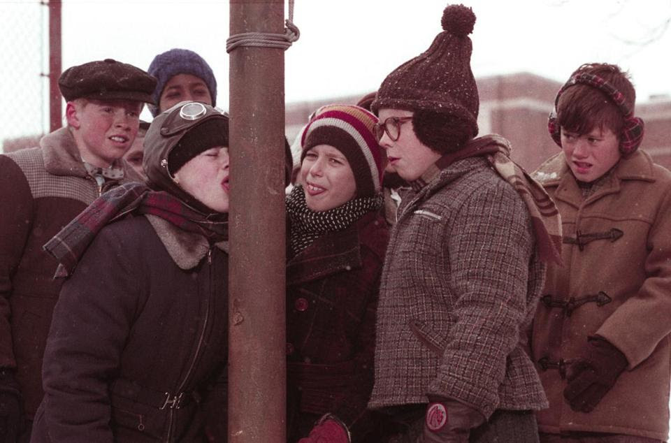 """Scene from the  1983 movie """"A Christmas Story"""" in which one of the characters gets his tongue stuck to a metal pole."""