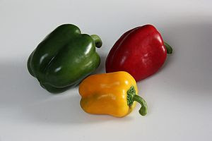 Green, yellow and red bell peppers from the ca...