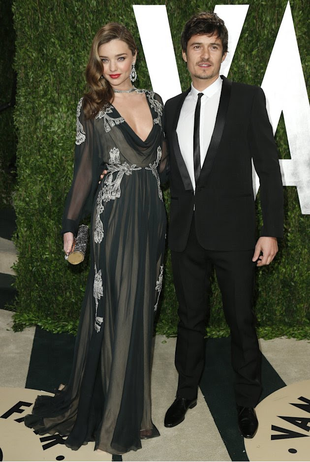 Actor Orlando Bloom and his wife, model Miranda Kerr arrive at the 2013 Vanity Fair Oscars Party in West Hollywood
