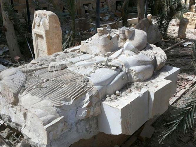 This photo released on Sunday March 27, 2016, by the Syrian official news agency SANA, shows a destroyed statue outside the damaged Palmyra Museum, in Palmyra city, central Syria. A Syrian antiquities official says demining experts have so far removed 150 bombs planted by the Islamic State group inside the archaeological site in the historic town of Palmyra. Syrian troops captured the town from IS fighters on Sunday after three weeks of intense fighting. (SANA via AP) (File: Mideast Syria Islamic State.JPEG-07112.jpg )