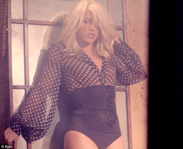Going dotty: Shakira wears a sheer shirt and black knickers for the dancing segment of the video
