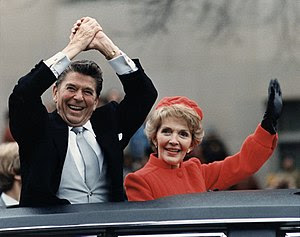 Ronald Reagan and Nancy Reagan waving from the...