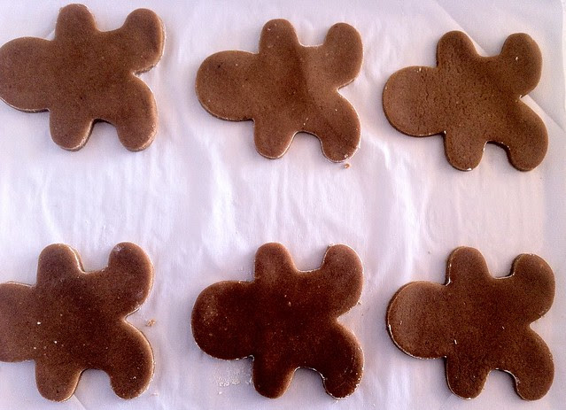 Gingerbread Men Cutouts on Lined Baking Sheets