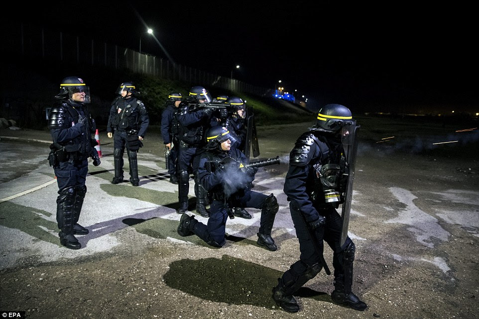 French police fired tear gas into the demonstrators during skirmishes in Calais last night