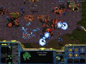 A Protoss force attacks a Zerg colony, shown f...