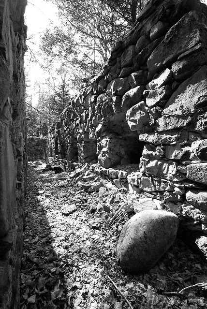 Black and white photo of a rock foundation.