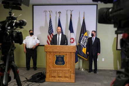 Indianapolis police chief says gunman bought weapons legally despite earlier warning.