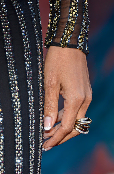 Actress Halle Berry (jewelry detail) arrives at the Oscars at Hollywood & Highland Center on February 24, 2013 in Hollywood, California.