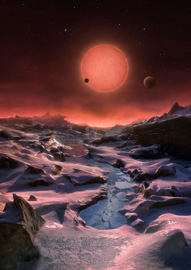 Ilustração artística mostra como seria a superfície de um dos três planetas que orbita uma estrela anã ultrafina que fica a apenas 40 anos luz da Terra (Foto: ESO/M. Kornmesser/AP)