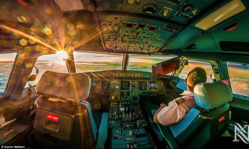 Panorama: This photograph is of a 1st officer enjoying the sunrise at 37,000 feet above sea level en route to Chittagong Bangladesh