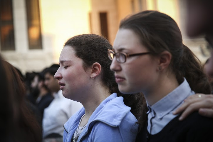 Thousands attend the funeral ceremony of three out of the four victims who were murdered by two Palestinians at a synagogue in the Ultra-Orthodox Har Nof neighbourhood in Jerusalem on November 18, 2014. Flash90