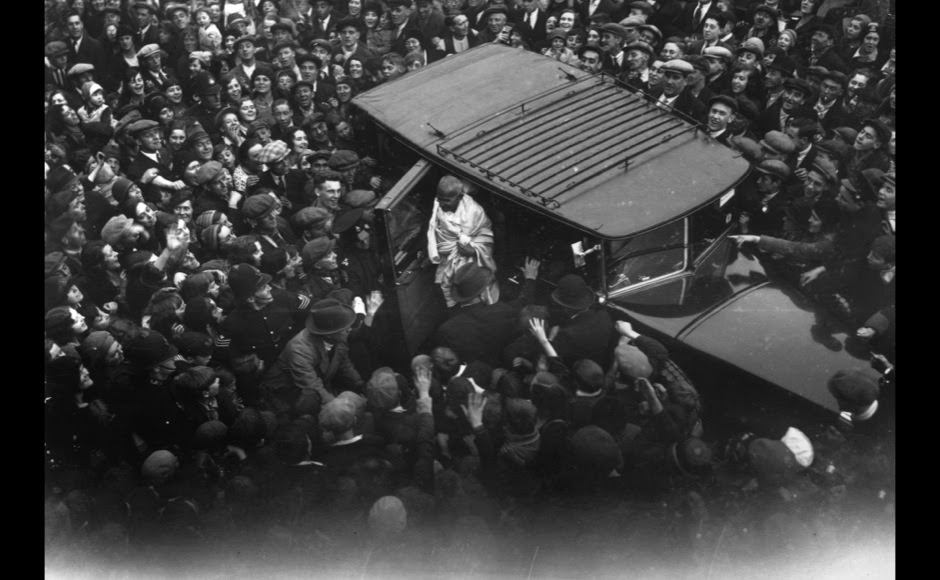 <p> An admiring East End crowd gathers to witness the arrival of Mahatma Gandhi on September 22, 1931 in East London, as he calls upon Charlie Chaplin. Getty Images</p>