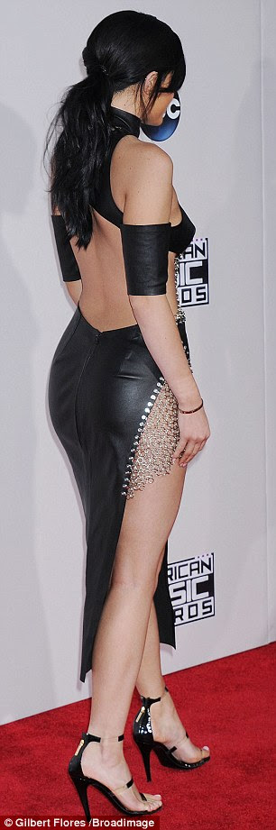 Cheeky! Kylie showed off her pert derriere in the figure-hugging leather dress