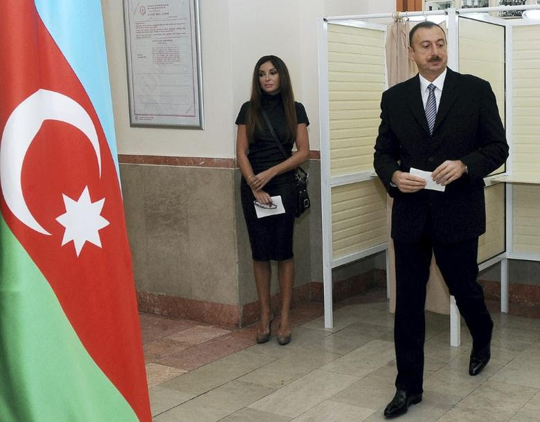 Azerbaijan's President Ilham Aliyev (R) leaves a voting booth next to his wife Mehriban at a polling station during parliamentary elections in Baku, November 7, 2010. REUTERS/Vugar Amrullaev