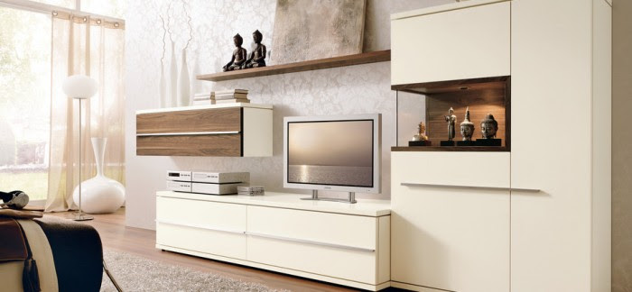 This Asian-inspired ivory space lends itself toward an elegant feminine style with lacy wallpaper, rounded accessories and daphenous window treatments. The media center offers a polarizing effect with its hard edges and cut-out features.