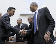 FILE -In this Dec. 8, 2011 file photo, House Judiciary Committee member Rep. Darryl Issa, R-Calif., left, shakes hands with Attorney General Eric Holder on Capitol Hill in Washington. Holder is proposing to meet with Issa by Monday to settle a dispute over Justice Department documents the congressman is demanding on a flawed gun-smuggling probe. (AP Photo/Susan Walsh, File)
