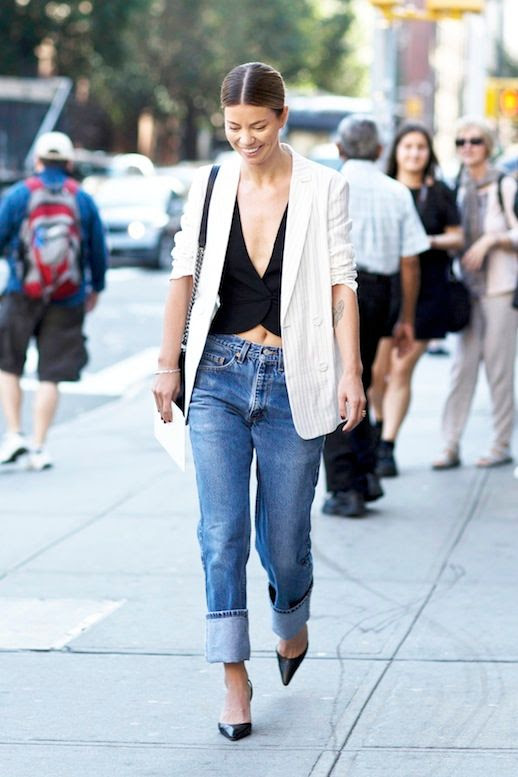 Le Fashion Blog Street Style Low Bun Sexy Polished Denim Look Pinstriped Blazer Crop Top Wth Plunging Neckline Cuffed Jeans Black Pumps Via Style Caster