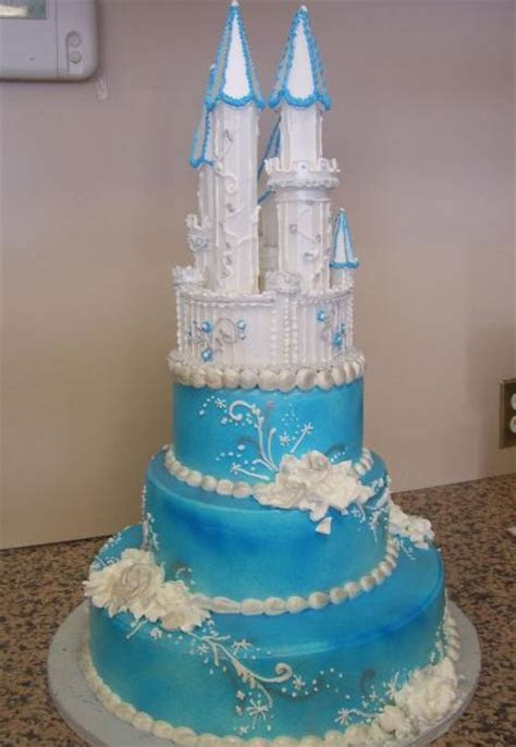 3 tier blue wedding cake with white castle on top with
