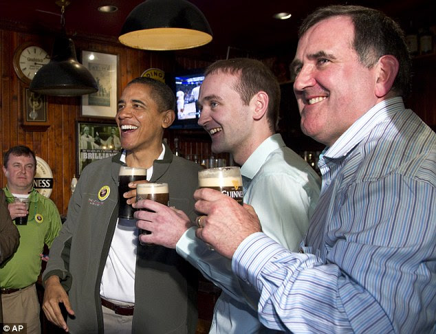 Family affair: Mr Obama's cousin from Moneygall Ireland, Henry Healy, center, shared a pint with the president alongside the owner of the pub in Moneygall Ireland, Ollie Hayes, right