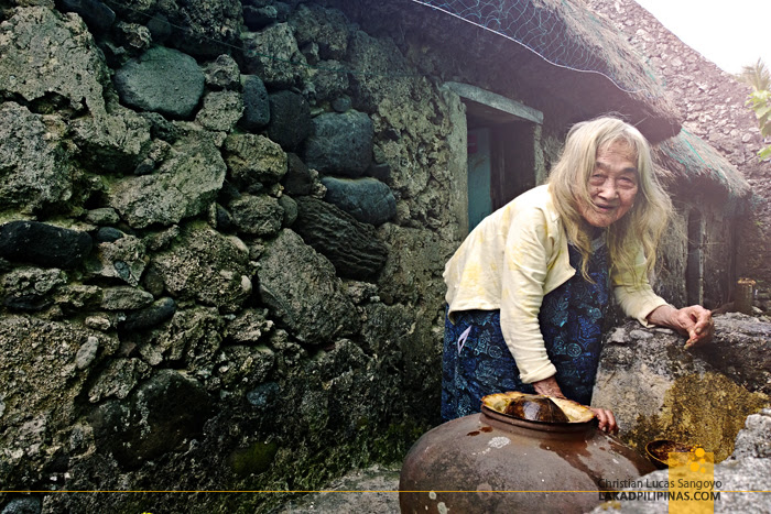 An Old Ivatan Fetching Water at Sabtang Island in Batanes
