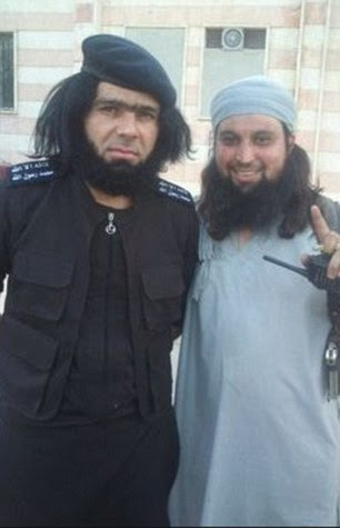 Hachim Chaib (right) has rapidly risen up the ISIS ranks - even being photographed alongside feared Anbar province commander, Abu Wahib (left)