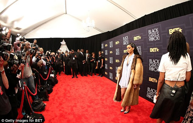 All eyes on her: With her expertly polished complexion and hairdo, the starlet looked picture perfect for all the photographers