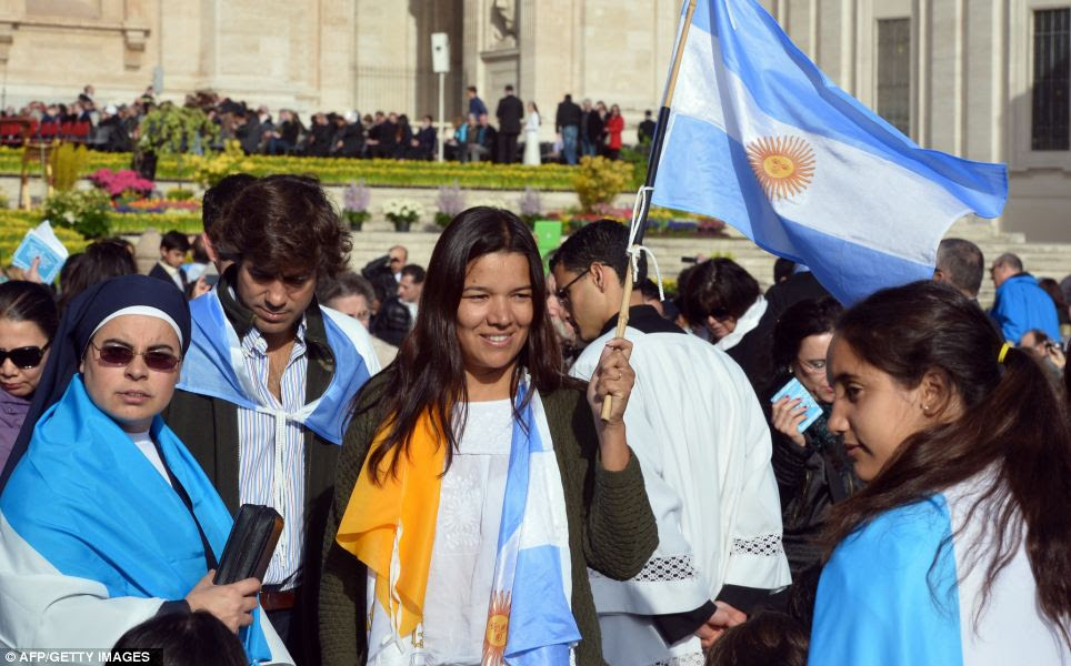 Flags: Pilgrims wave an Argentinian flag in honour of Pope Frances before the Easter celebrations today