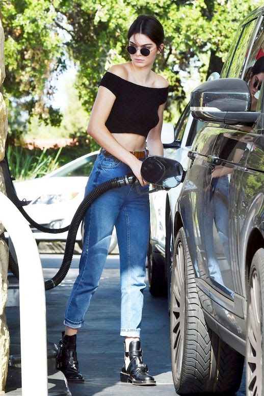 Le Fashion Blog Model Style Kendall Jenner Round Sunglasses Black Off The Shoulder Crop Top High Waisted Jeans Balenciaga Cut Out Buckle Boots Via Elle