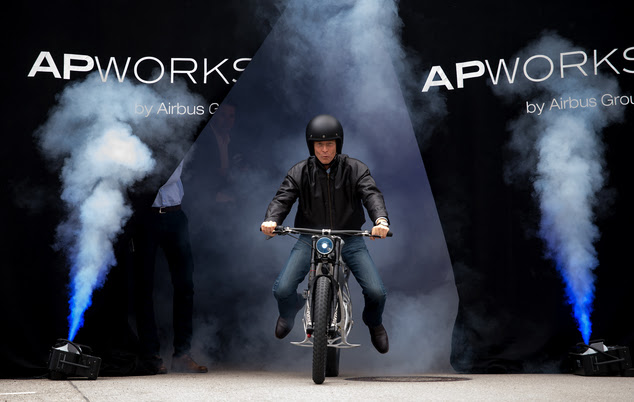 The CEOof Airbus, Tom Enders, presents the first 3D printed electric motorcycle in Ottobrunn, Germany,  Friday  May 20,  2016. The motorcycle was made of metal powder by using lasermelting technology. The  bike only weighs 35 kilos.  (Sven Hoppe/dpa via AP)