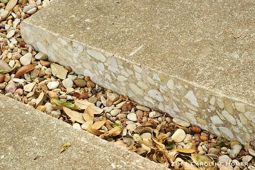 The cut edge of driveway concrete
