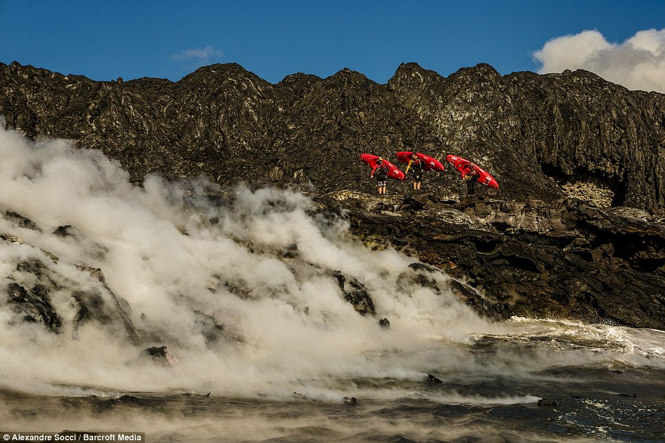 Melting: Pedro Oliva, Chris Korbulic, and Ben Stookesberry carry their kayaks over solidified lava flows in Kauai, Hawaii