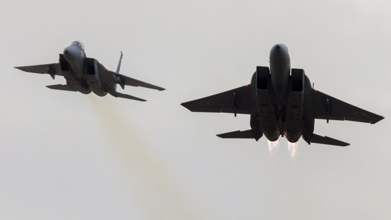 File Photo:  Two Israeli Air Force F-15 fighter jets fly close together during a display at Hatzerim Air Force base outside Beersheba, Israel. EPA, JIM HOLLANDER
