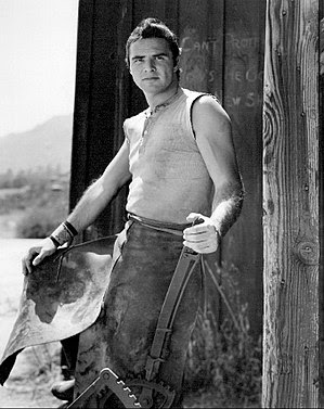 Publicity photo of Burt Reynolds as blacksmith...