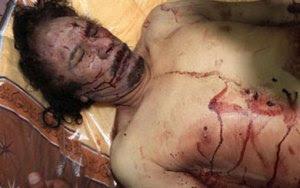 http://prensapcv.wordpress.com/2011/10/21/reacciones-frente-al-magnicidio-del-lider-libio-muammar-al-gaddafi/asesinato_gaddafi_002/