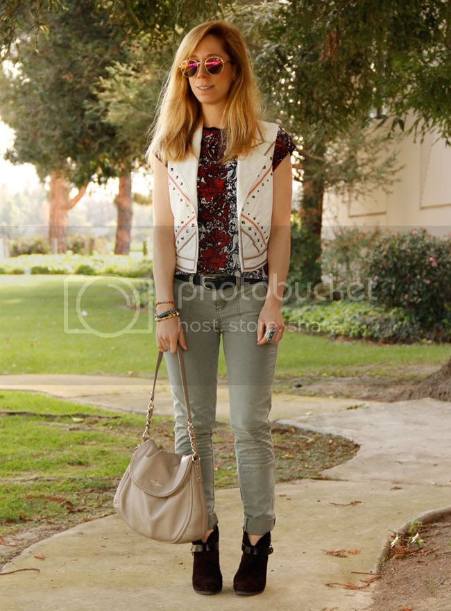 LA fashion blogger The Key To Chic wears a faux leather Southwestern vest with Rag & Bone Harrow boots, Mossimo moto pants, and a Kate Spade Penny bag.