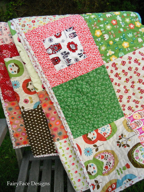Matryoshka quilt draped on chair