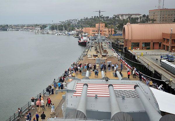 A crowd gathers on the USS Iowa's bow after it officially became a floating museum at San Pedro's Berth 87, on July 7, 2012.