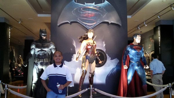 Posing with the Batman, Wonder Woman and Superman costumes used in BATMAN V SUPERMAN: DAWN OF JUSTICE...at Warner Bros studio on September 8, 2015.