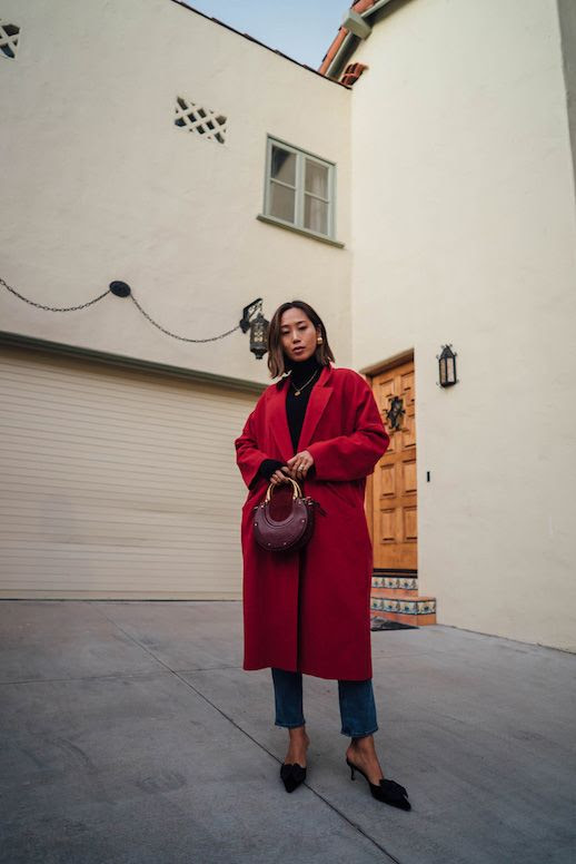 Le Fashion Blog Red Wool Coat Black Turtleneck Cropped Jeans Black Bow Front Heels Via Song Of Style
